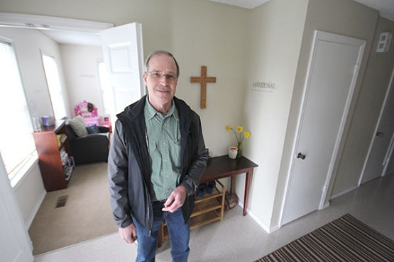 "Ed Langlois/Catholic SentinelAl Schmitt, outreach coordinator for Holy Trinity Parish, stands in a 10-bedroom house the parish purchased to care for refugees and local homeless families. ""People feel so good, and feel so comfortable in this church, they want to give back,"" Schmitt says of Holy Trinity."