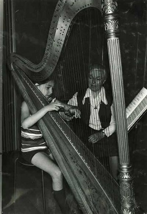 YMA photoA student learns harp from  Sister Emerentia Berndorfner.