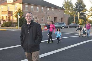 St. Mary School photoRick Schindler, principal of St. Mary School in Stayton, stands outside where he greets students each morning. A bus will now bring students from outlying areas like Albany.