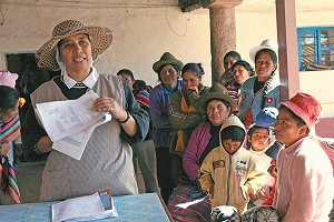Catholic News ServiceSister Margarita Guevara, a Franciscan Missionary of Mary from Colombia, goes over the names of mothers who will take turns cooking lunch for 140 children at the parish in Zurite, Peru. According to health officials, more than a third of the town 's people suffer from malnutrition.
