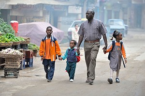 Catholic News Service photoAbdel Karim, a refugee from the Darfur region of Sudan, walks his children to school in early November in Cairo. Karim has taken adult education classes sponsored by St. Andrew's Refugee Services, which is supported by Catholic Relief Services.