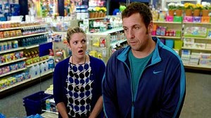 "Drew Barrymore and Adam Sandler star in a scene from the movie ""Blended."" The Catholic News Service classification is A-II -- adults and adolescents. The Motion Picture Association of America rating is PG-13 -- parents strongly cautioned. Some material m ay be inappropriate for children under 13. (CNS photo/Warner Bros.)"