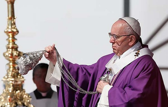 Pope Francis uses incense as he celebrates Mass in Ecatepec near Mexico City Feb. 14.