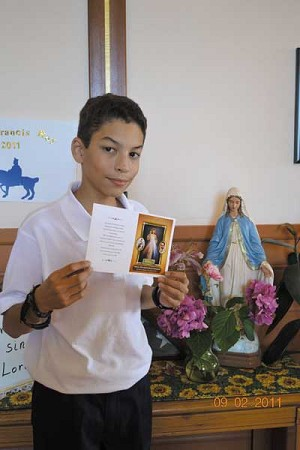 Seancarlos Gonzalez shows a prayer he wrote to promote family unity.