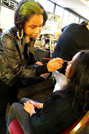 Paul Mitchell stylist Shaniqua Thomas helps high school senior Arielle Pendergrass with prom makeup ideas.