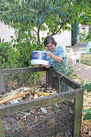 Robyn Dowell takes out the compost daily, one of her responsibilities at the L'Arche Neahkahnie House.