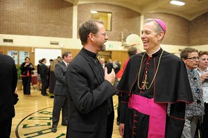 Fr. John Kerns of Lake Oswego meets the new archbishop.